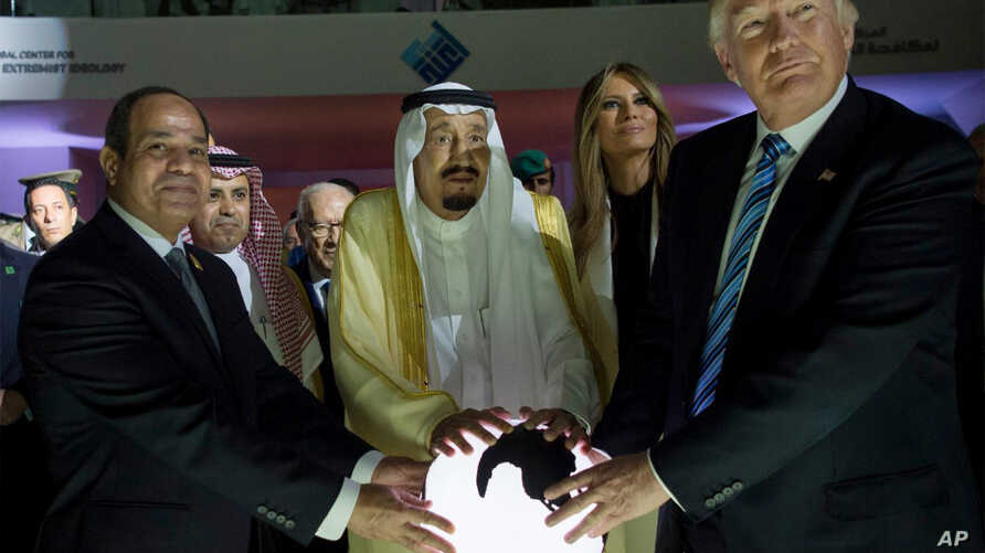 FILE - In this May 21, 2017 photo released by the Saudi Press Agency, from left to right, Egyptian President Abdel Fattah al-Sissi, Saudi King Salman, U.S. First Lady Melania Trump and President Donald Trump, visit a new Global Center for Combating E