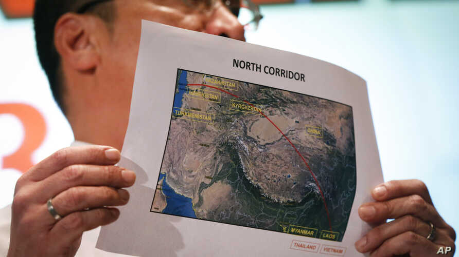 Malaysia's acting Transport Minister Hishamuddin Hussein shows the map of northern search corridor during a press conference at a hotel next to the Kuala Lumpur International Airport, in Sepang, Malaysia, March 17, 2014.