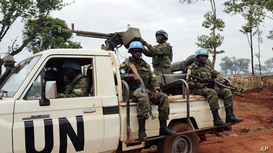 In this photo taken May 26, 2017, U.N. peacekeepers patrol outside Bria, Central African Republic. The United Nations said at the time that about 300 people had been killed and 200 wounded in the previous two weeks in Bria and a handful of other town