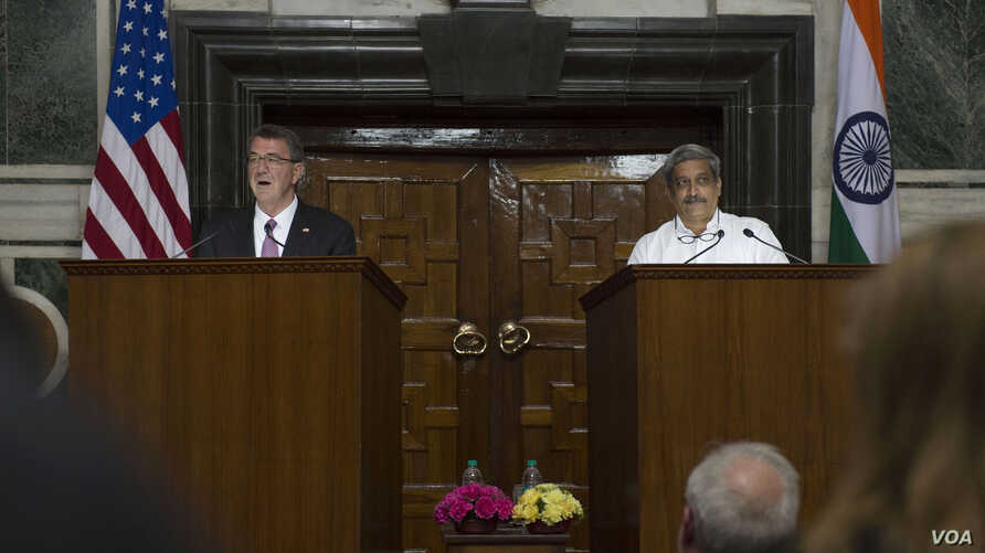 U.S. Secretary of Defense Ash Carter, left, speaks during a joint news conference with Indian Defense Minister Manohar Parrikar in New Dehli, India, April 12, 2016.