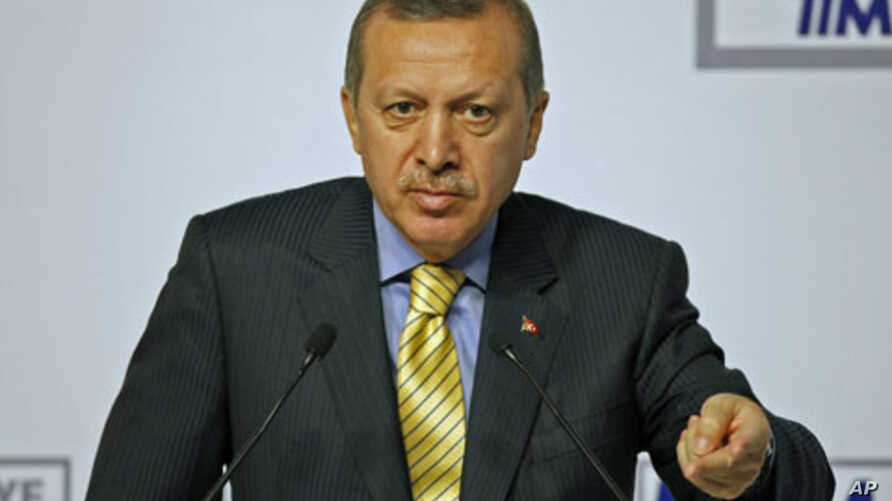 Turkey's Prime Minister Recep Tayyip Erdogan presses for NATO to have sole control over all military operations in Libya during a conference at his office in Istanbul, March 24, 2011