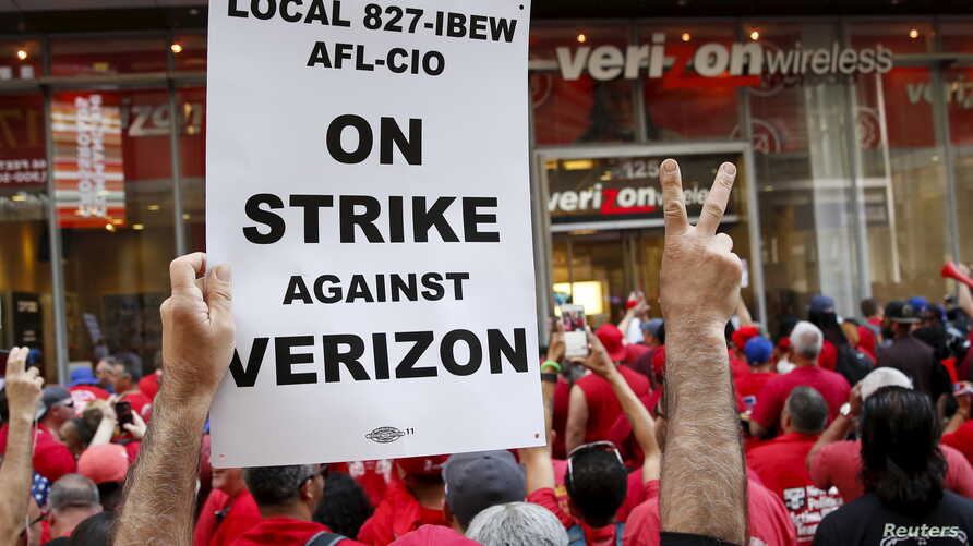 People demonstrate outside a Verizon wireless store during a strike in New York, U.S., April 18, 2016.