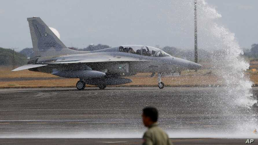 One of two newly-acquired FA-50PH fighter jets is given a water cannon salute while taxiing on the runway upon landing, Nov. 28, 2015 at Clark Air Base in Pampanga province, Philippines.