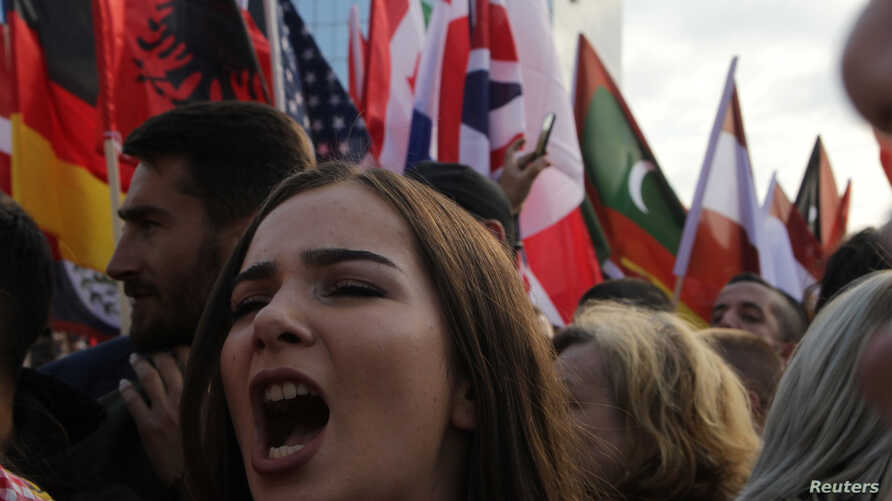 A women shouts as people protest against Kosovo President Hashim Thaci's border change proposal deal with Serbia in Pristina, Kosovo, Sept. 29, 2018.