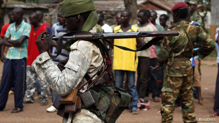 A Chad soldier holds his weapon in Bangui, Central African Republic, Dec. 9, 2013.
