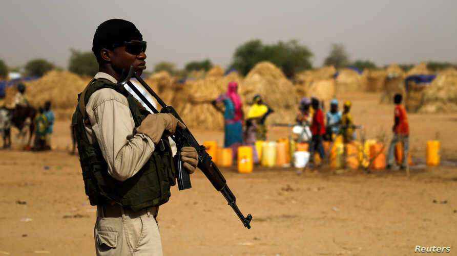 A Nigerien soldier stands guard in a camp of the city of Diffa during the visit of Niger's Interior Minister Mohamed Bazoum following attacks by Boko Haram fighters in the region of Diffa, Niger, June 18,2016.