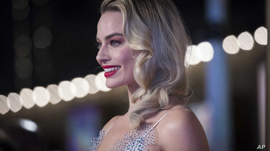 FILE - Actress Margot Robbie poses for photographers upon arrival at the premiere of the film 'Mary Queen of Scots', in London, Dec. 10, 2018.