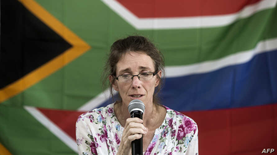 FILE - South African Yolande Korkie, a former hostage and wife of Pierre Korkie, holds a press conference in Johannesburg to appeal for the release of her husband held in Yemen.