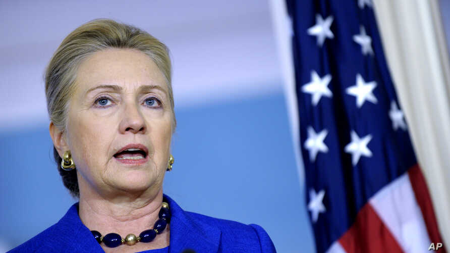 Secretary of State Hillary Clinton answers a reporter's question on Libya during a joint news conference with Brazil's Foreign Minister Antonion de Aguiar Patriota, October 24, 2012, at the State Department in Washington.