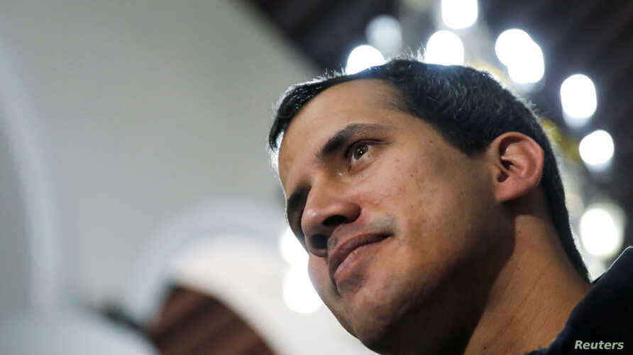 FILE PHOTO: Venezuelan opposition leader and self-proclaimed interim president Juan Guaido arrives to attend a holy mass in Caracas, Jan. 27, 2019.