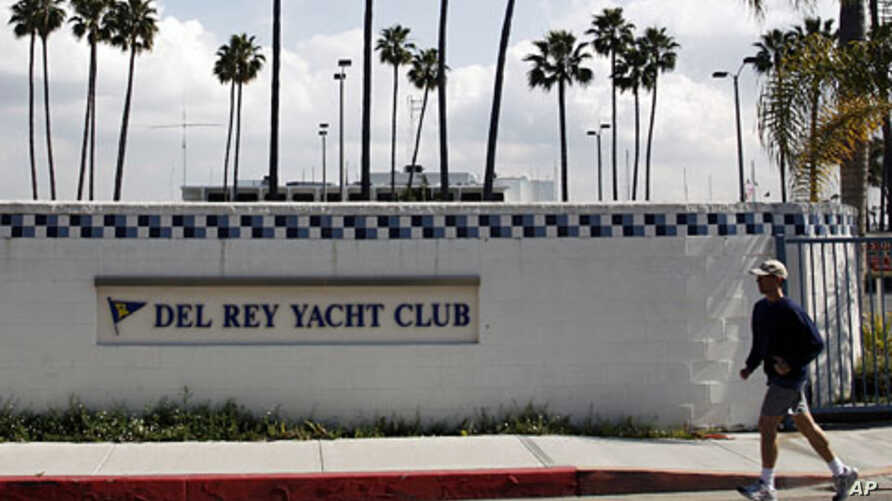A man jogs past the Del Rey Yacht Club in California, where Jean and Scott Adams, two of the four Americans killed by Somali pirates, were members  (File)
