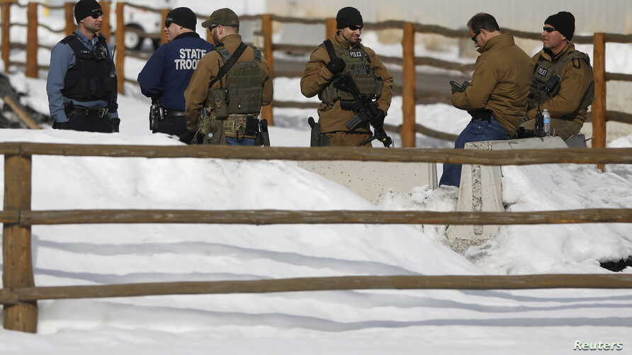 FILE - Members of the Oregon State Troopers and FBI are seen as in Burns, Oregon Jan. 31, 2016. Four armed occupants remain at the Malheur National Wildlife Refuge near Burns.