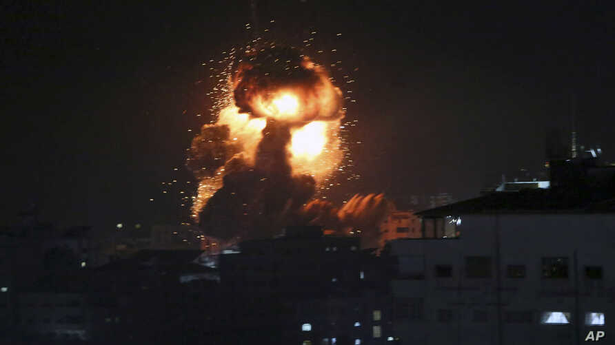 An explosion caused by Israeli airstrikes is seen from the offices of Hamas leader Ismail Haniyeh, in Gaza City, Monday, March 25, 2019.