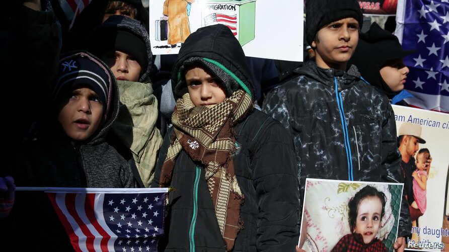 FILE - New York Yemeni Americans demonstrate in response to U.S. President Donald Trump's travel ban and recent denials of visa applications in Foley Square in lower Manhattan in New York City, Dec. 27, 2017.