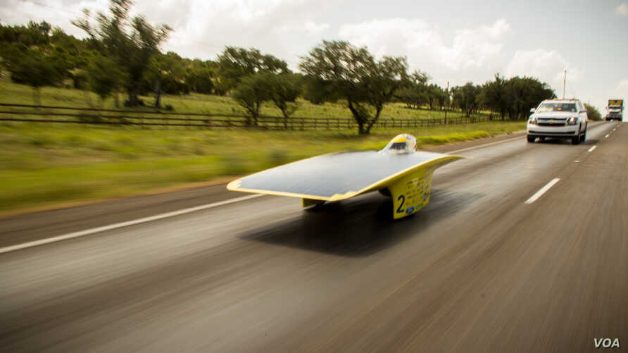 University of Michigan's 2014 solar car, Quantum, speeds down the highway in the American Solar Challenge. (Darren Cheng)