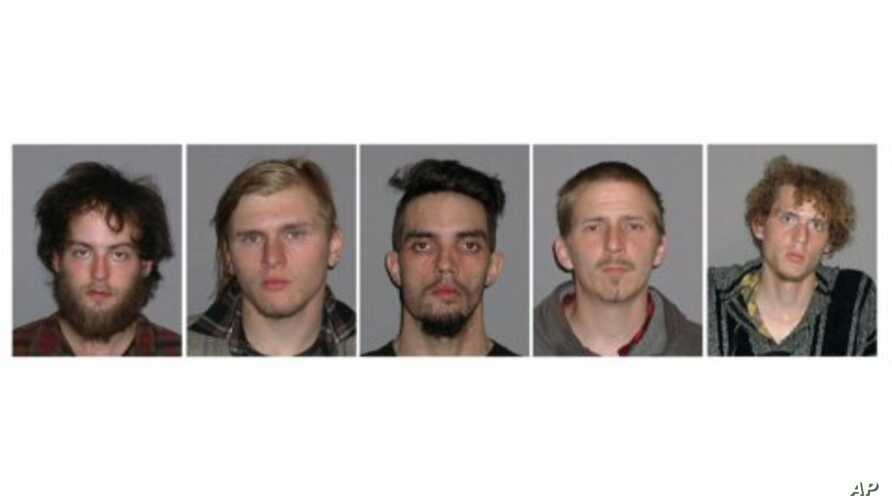 This combination of handout booking photos provided May 1, 2012 by the FBI shows L-R: Connor Stevens, Brandon Baxter, Douglas Wright, Anthony Hayne and Joshua Stafford.