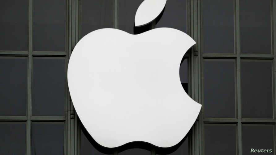 FILE - The Apple Inc. logo is shown outside the company's Worldwide Developers Conference in San Francisco, California, June 13, 2016.