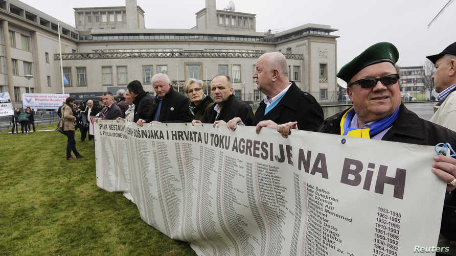 Bosnian survivors and family members gather outside the International Criminal Tribunal for former Yugoslavia (ICTY) before the verdict announcement in the genocide trial of former Bosnian Serb leader Radovan Karadzic in the Hague, the Netherlands, M