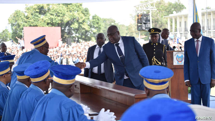 Felix Tshisekedi shakes hands with members of the Constitutional Court during his inauguration ceremony as the new president of the Democratic Republic of Congo, at the Palais de la Nation, in Kinshasa, Jan. 24, 2019. On Monday, a new parliament was