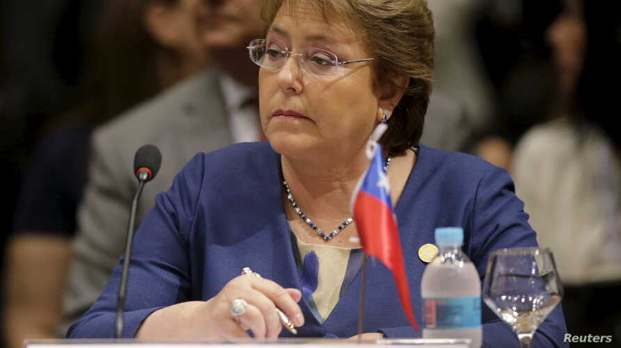 FILE - Chile's President Michelle Bachelet attends a session of the Summit of Heads of State of MERCOSUR and Associated States in Luque, Paraguay, Dec. 21, 2015.