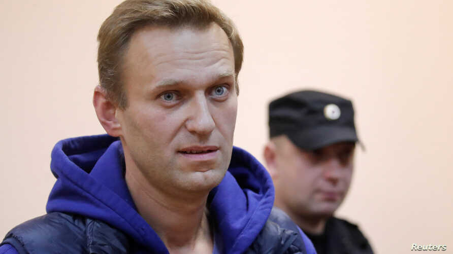 Russian opposition leader Alexei Navalny, who was detained over allegations of staging illegal protests, attends a court hearing in Moscow, Russia, Sept. 24, 2018.