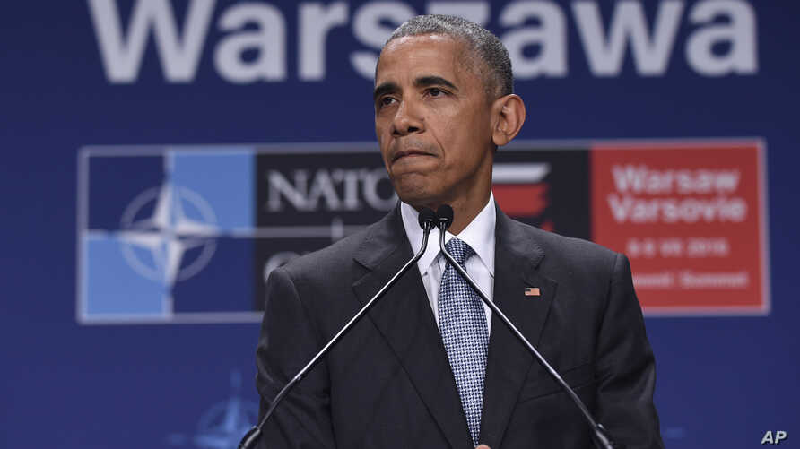 President Barack Obama pauses while speaking about the events in Dallas at the beginning of his news conference at PGE National Stadium in Warsaw, Poland, July 9, 2016. Obama is in Warsaw attending the NATO Summit.