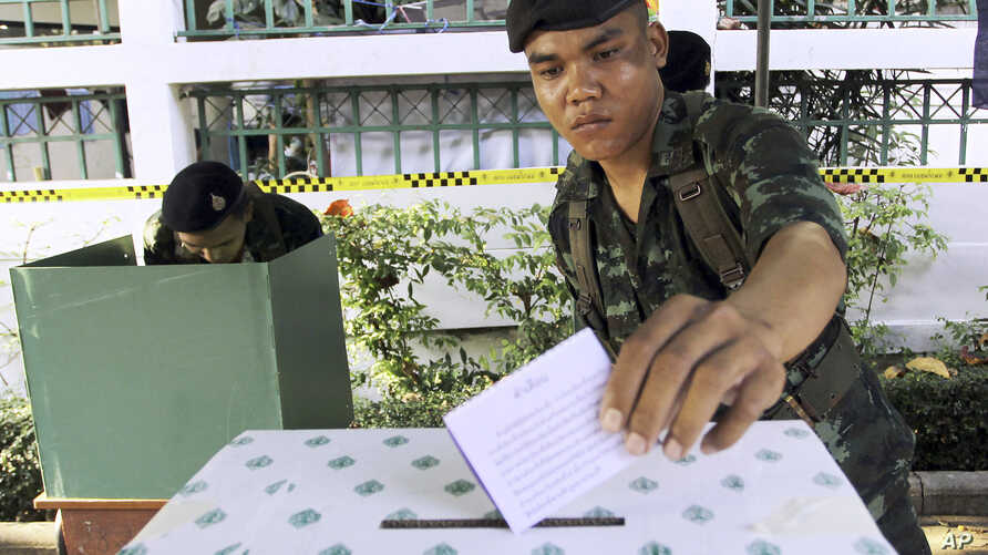 FILE - A Thai soldier casts his vote during the general election at a polling station in Bangkok, Thailand, Feb. 2, 2014. Thailand has taken another step toward holding elections in 2019 by easing some restrictions on political activities to allow pa