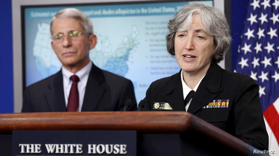 FILE - Dr. Anne Schuchat, principal deputy director for Centers of Disease Control Prevention, and Dr. Anthony Fauci, director of the National Institute for Allergy and Infectious Disease, speak at the White House in Washington, April 11, 2016.
