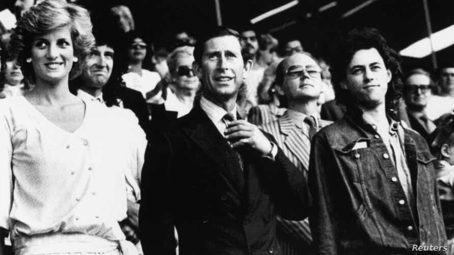 Princess Diana and Prince Charles stand with Bob Geldof in the Royal Box at Wembley Stadium today as they arrive for the start of the Live Aid Transatlantic Spectacular designed to raise millions of dollars for starving Africans, in London, on July 1