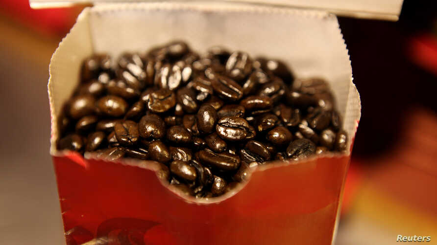 FILE — Coffee beans are seen in a bag at a branch of Nairobi Java House in Nairobi.