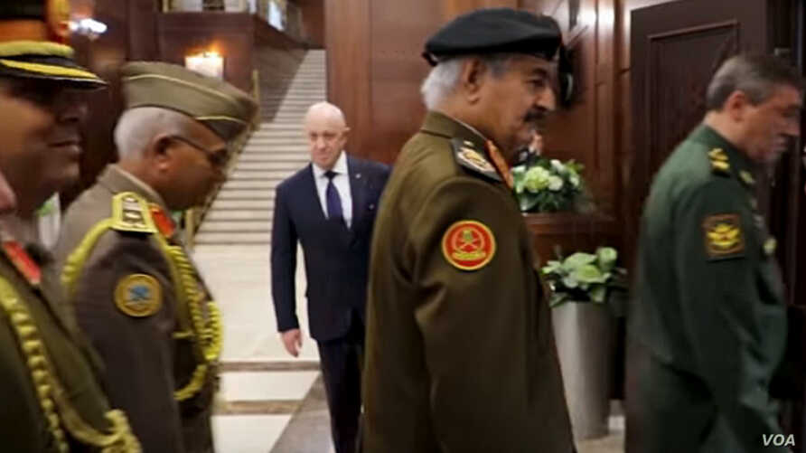 Yevgeny Prigozhin, background center, is seen at a meeting between Russian and Libyan military officials in Moscow, in a screengrab from footage published Nov. 7, 2018, by the self-styled Libyan National Army.