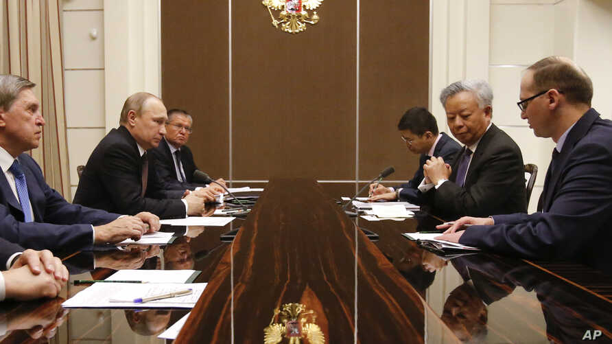 Russian President Vladimir Putin (2-L) meets with the President of the Asian Infrastructure Investment Bank (AIIB) Jin Liqun (2-R) in the Bocharov Ruchei residence in Sochi, Russia, May 18, 2016.