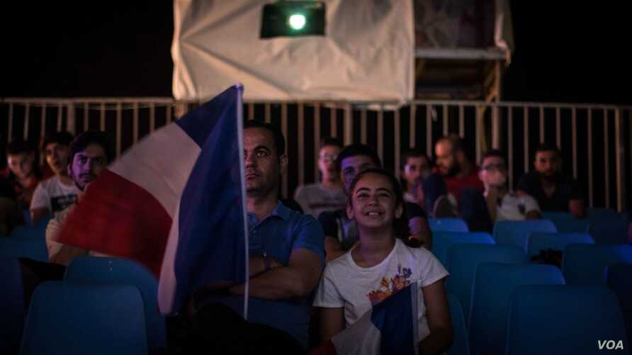 A father and daughter take in France's opening game together. The European championships are being held across the country.