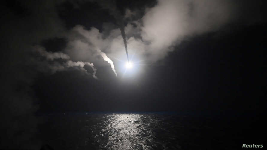 U.S. Navy guided-missile destroyer USS Porter (DDG 78) conducts strike operations while in the Mediterranean Sea which U.S. Defense Department said was a part of cruise missile strike against Syria  on April 7, 2017.  Ford Williams/Courtesy U.S. Navy