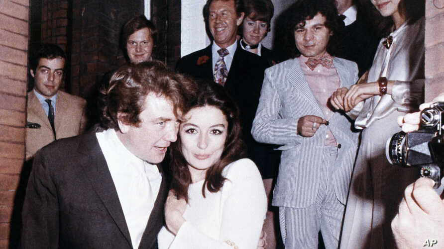 "FILE  - In this 1970 file photo, British actor Albert Finney embraces his bride, French Actress Anouk Aimee, after their registry office wedding in London. Finney, the Academy Award-nominated star of films from ""Tom Jones"" to ""Skyfall"" has died at th"