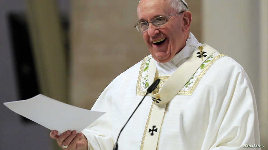Pope Francis smiles as he delivers his messages during a mass at the Cathedral church in Manila in the Philippines, Jan. 16, 2015.