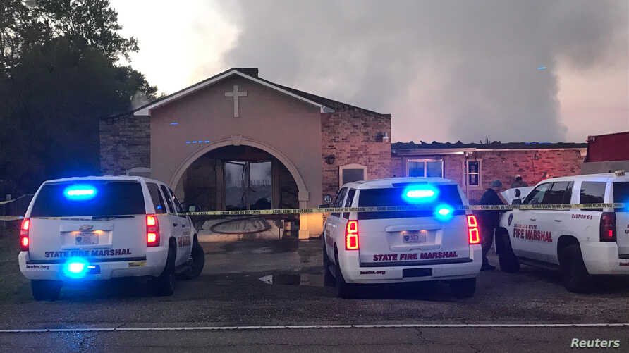 Louisiana State Fire Marshall vehicles are seen outside the Greater Union Baptist Church during a fire, in Opelousas, April 2, 2019, in this picture obtained from social media.