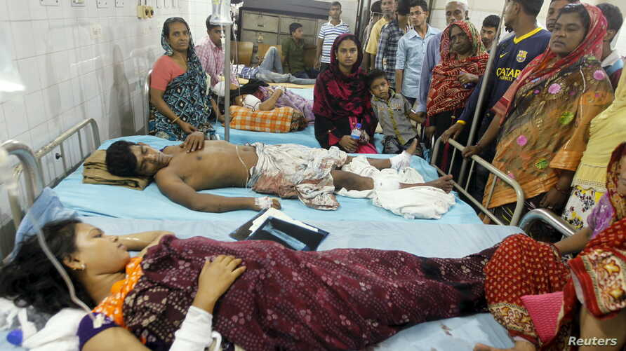 People who sustained injuries in a series of blasts are surrounded by their relatives at a hospital in Dhaka, Oct. 24, 2015.