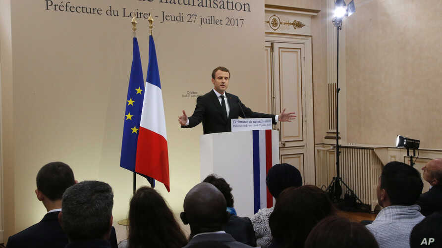 French President Emmanuel Macron gestures as he delivers a speech during a citizenship ceremony in Orleans, central France, July 27, 2017.