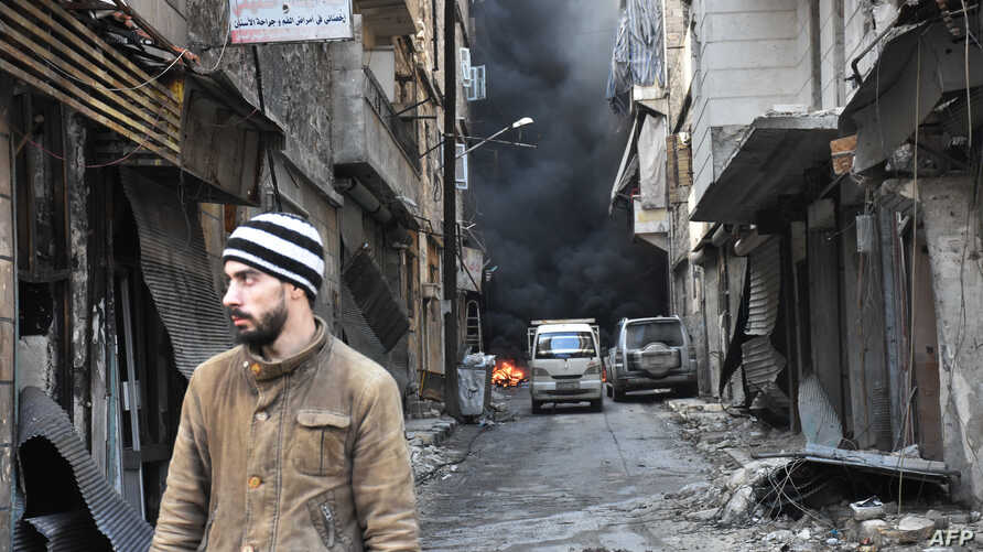 A Syrian man walks through the former rebel-held Salaheddin district in the northern Syrian city of Aleppo.