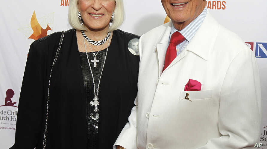 FILE - Pat and Shirley Boone arrive at Lipscomb University for the Dove Awards, Oct. 7, 2014, in Nashville, Tenn.