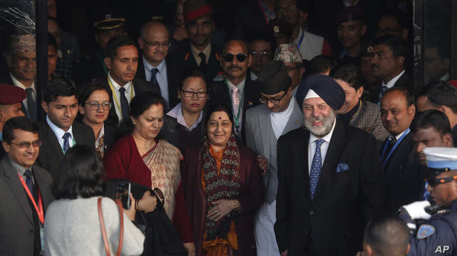 Indian External Affairs minister Sushma Swaraj (C) arrives at Tribhuwan International Airport, Kathmandu, Nepal, Feb. 1, 2018.