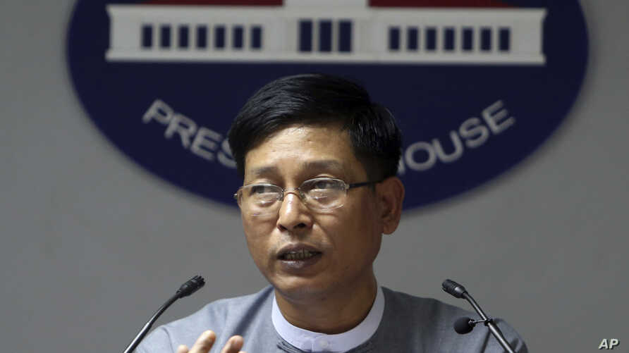 FILE - Myanmar government spokesman Zaw Htay talks to journalists during a news briefing at the Presidential Palace in Naypyitaw, Myanmar, Sept 13, 2017.