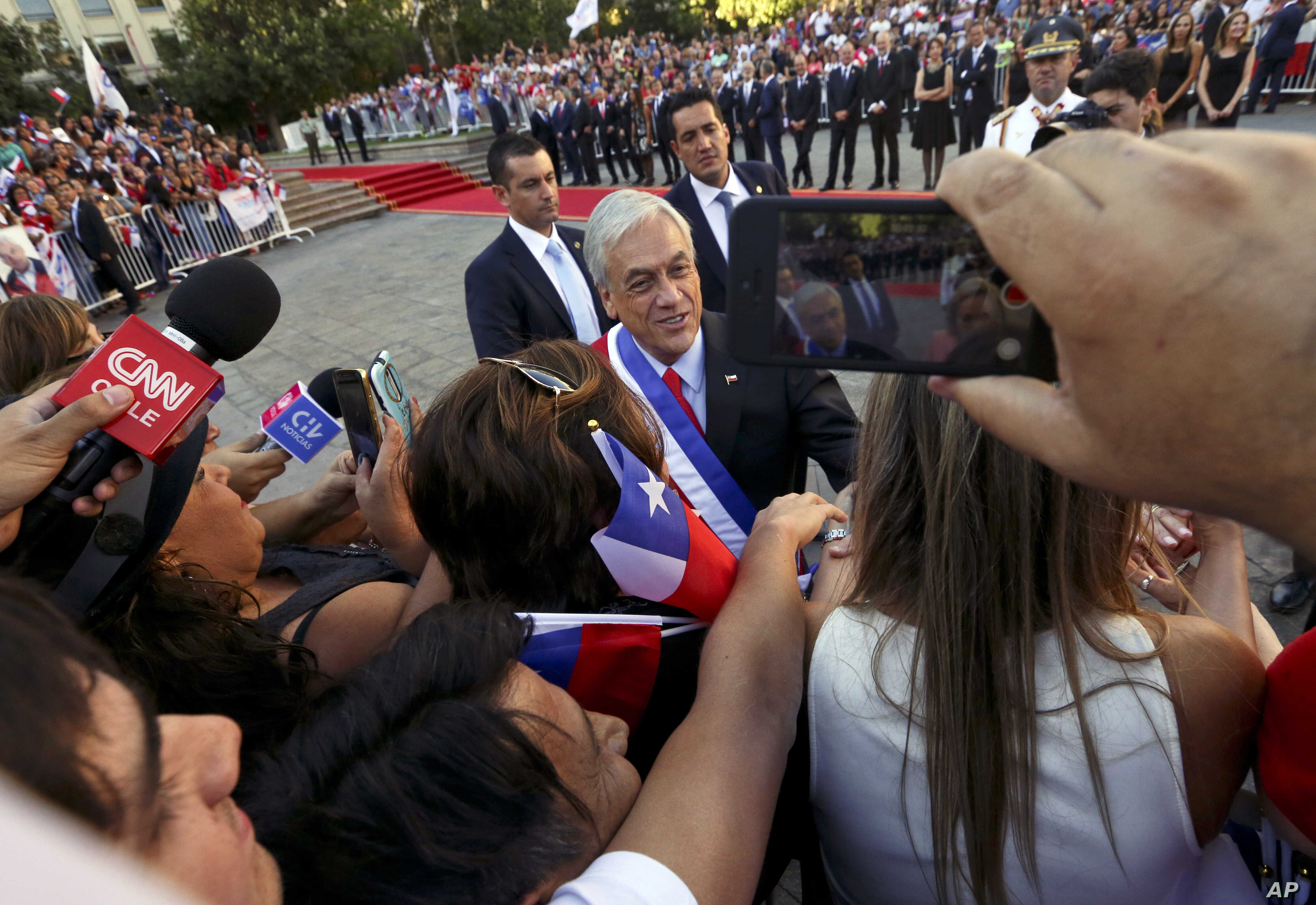 Chile's President Sebastian Pinera greets supporters outside La Moneda presidential palace on the day of his inauguration in Santiago, Chile, Sunday, March 11, 2018.