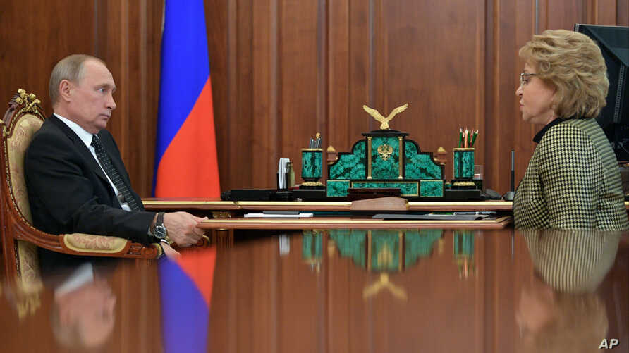 FILE - Russian President Vladimir Putin, left, meets with the speaker of the Federation Council, upper parliament chamber Valentina Matviyenko at the Novo-Ogaryovo residence, outside Moscow, Russia, June 26, 2017.
