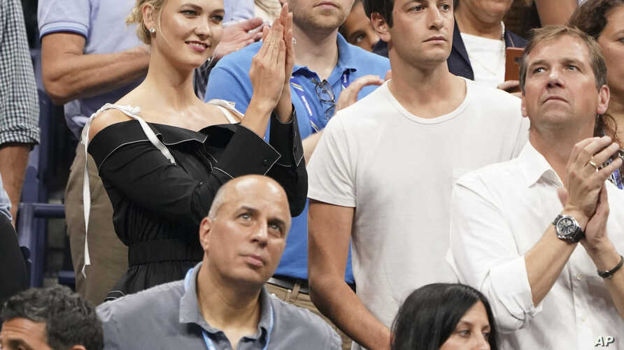 FILE - Karlie Kloss, top left, and Joshua Kushner attend the semifinals of the U.S. Open tennis tournament at the USTA Billie Jean King National Tennis Center, Sept. 6, 2018, in New York.