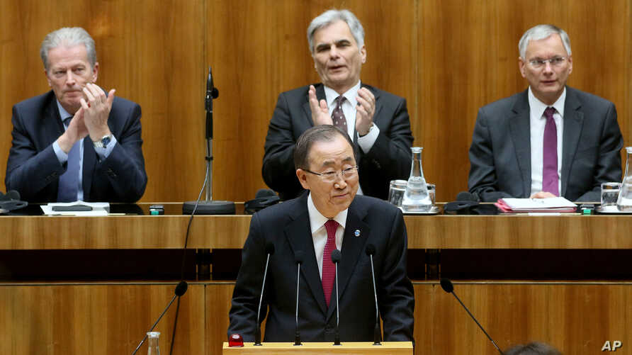 U.N. Secretary General Ban Ki-moon, center, waves during a session of Austria's lower house at the parliament in Vienna, Austria, April 28, 2016.
