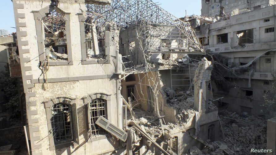 An Ottoman-era building damaged by an air strike at a besieged area in Homs, November 28, 2012.