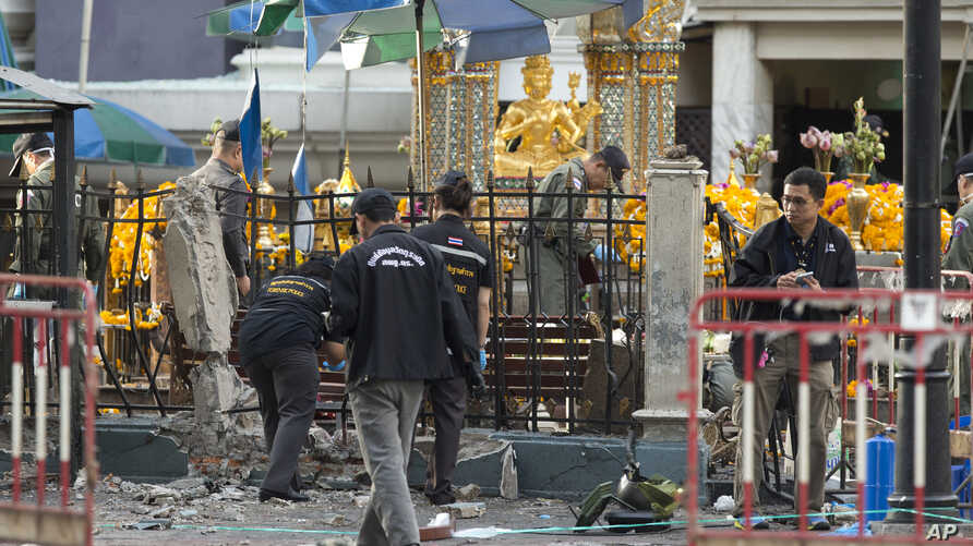 Police investigate a scene the morning after an explosion in Bangkok,Thailand, Tuesday, Aug. 18, 2015.