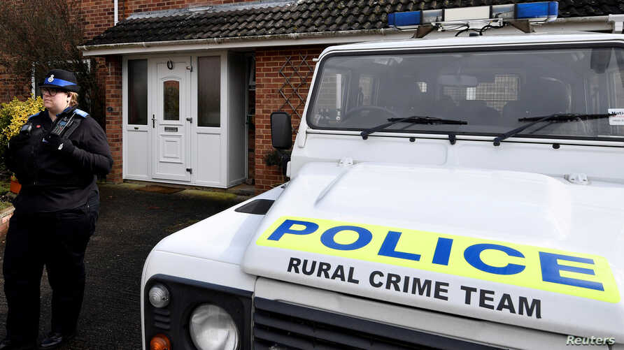 FILE - A police officer stands guard outside of the home of former Russian military intelligence officer Sergei Skripal, in Salisbury, Britain, March 6, 2018.